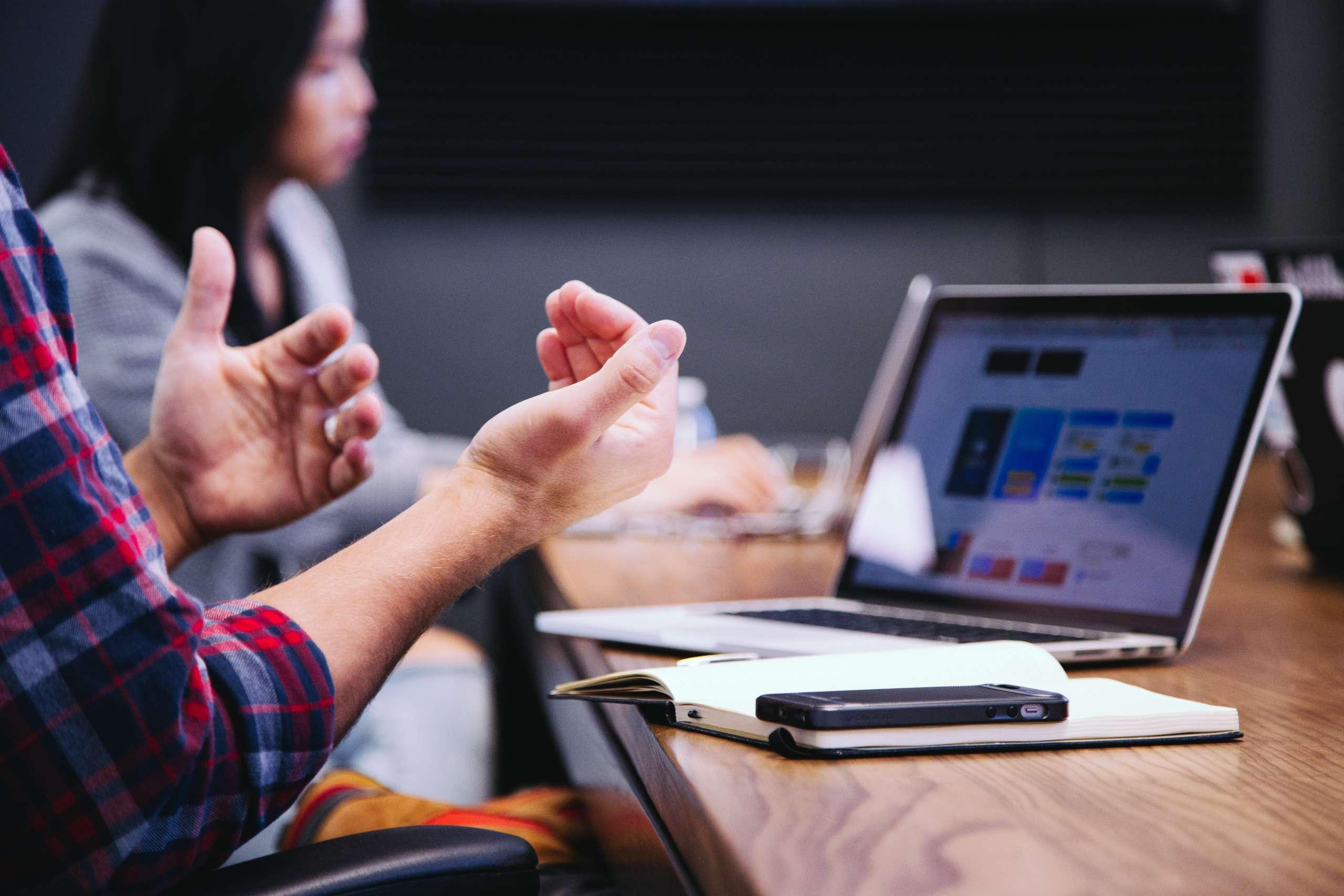 Man gesturing in meeting